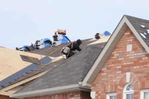 Roofers repairing a home in Fredericksburg, Virginia